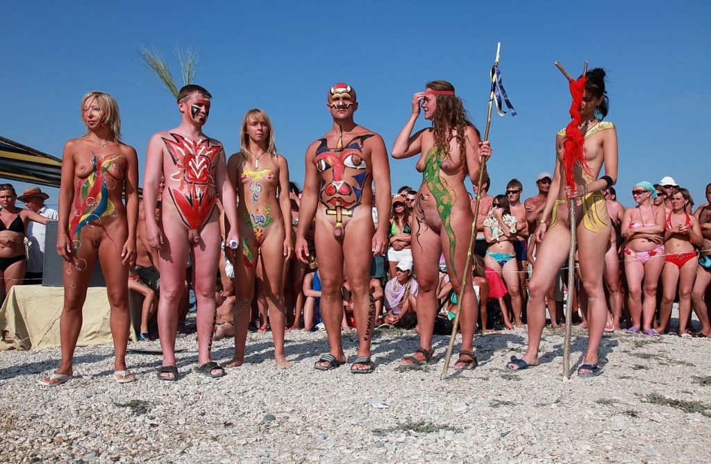Sun-Lit Beach Naturists